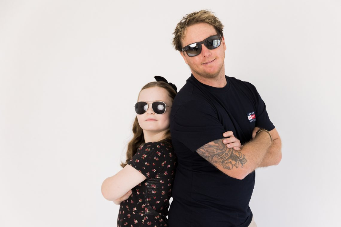 cool dad and daughter portrait in studio